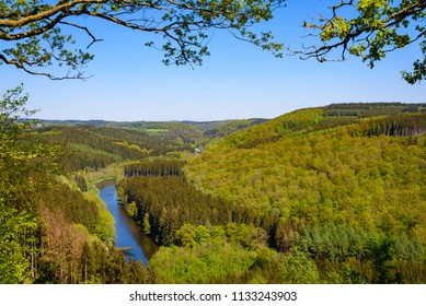 Semois river, Bouillon, Ardennes, Belgium. Panorama view on semois river. Belgian countryside forests with hills in background, Luxembourg province, Ardennes region, Wallonia, Belgium.