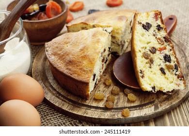 Semolina cake with dried fruits on a cutting board. Mannik