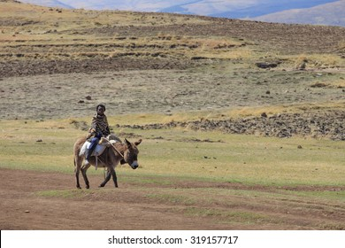 """Semonkong-SEPT 19:Basotho man wearing traditional blanket on a horse September 19,2015 in Semonkong,Lesotho. The horse is """"Basuto"""" a pony breed from Lesotho and SA they are popular in the mountains"""