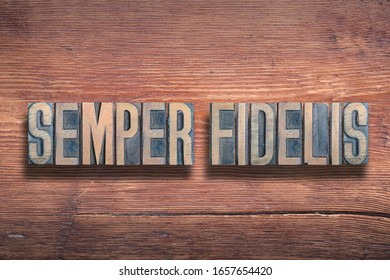 semper fidelis ancient Latin saying meaning - always faithful, combined on vintage varnished wooden surface