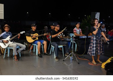 Semporna, Borneo - 13 December 2016: Local busker performing to the audience