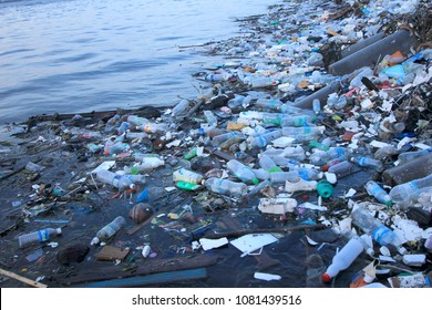 SEMPORNA, MALAYSIA - CIRCA MAY 2018: Plastic rubbish pollution in ocean. Plastic water bottles and bags thrown directly into the sea with no proper trash collection or recycling.