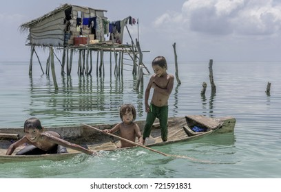 Semporna, Malaysia June 2015: Bajau tribal kids having fun by jumping into sea from their boat, Sabah Semporna, Malaysia