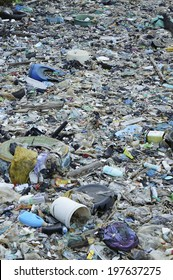 SEMPORNA, MALAYSIA - JUNE 4 2014: Plastic rubbish pollution in ocean. Photo showing pollution problem of garbage thrown directly into the sea with no proper trash collection or recycling.