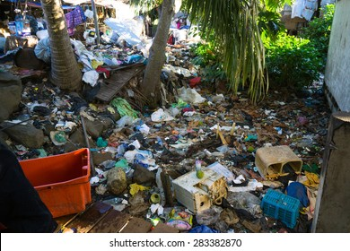 SEMPORNA, MALAYSIA - JUNE 4 2014: Plastic rubbish pollution in home area. Shot showing pollution problem of garbage thrown directly into the sea and home without  proper trash collection or recycling.