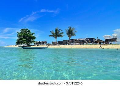 SEMPORNA, MALAYSIA - MAY 11 2015; Sea Gypsy Village (Bajau Laut) in Gusungan Island, Sabah, Malaysia. The Bajau Laut are the sea gypsies who live in the open sea.