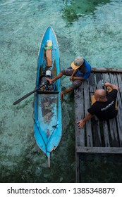 Semporna, Sabah, Malaysia. April 13, 2019 Local sea gypsy in Mabul Island selling the fish and sea shell by their small boat in Semporna, Sabah