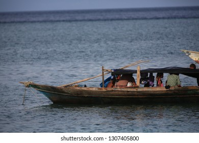 SEMPORNA, SABAH, MALAYSIA - April 2018: Unidentified Bajau Laut people and kids on a boat in Mabul Island. They inhabit villages built on stilts in the middle of sea, boat is the main transportation.