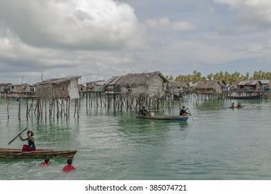 SEMPORNA, SABAH, MALAYSIA - OCT 2010 : SEMPORNA, MALAYSIA . Sea Gypsy Village (Bajau Laut) in Bodgaya Island, Sabah, Malaysia. The Bajau Laut are the sea gypsies who live in the open sea.
