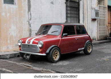 Semporna, Sabah  - Oct 18, 2017:  Red Mini Cooper car parked in a street of the small city Semporna Sabah.