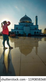 Semporna, Sabah - Sept 22, 2018 : Tourist with posing in light in the Semporna mosque known as Ar Rahman mosque at Semporna, Sabah. Considered as one of the most beautiful mosques in the Sabah,Borneo.