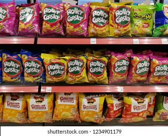Senai, Johor, Malaysia. October 17, 2018. Various choices of potato based snacks by brands Mister Potato and Roller Coaster for sale on the shelves of the 7-eleven convenience store.