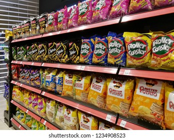 Senai, Johor, Malaysia. October 17, 2018. Various brands of potato snacks from name brands, Roller Coaster, Mister Potato, Chipster, Twisties for sale on the shelves of 7-eleven.