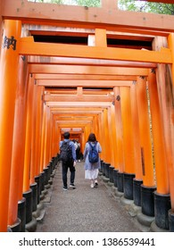 Senbon Torii at Fushimi Inari Shrine (Japan: Kyoto). Torii is the gate of a shrine. It is written as Votive in the torii.