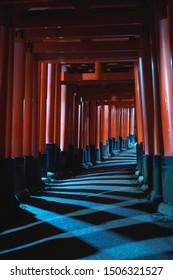 Senbon torii in Fushimi Inari Taisha shrine at night, Kyoto, Japan.