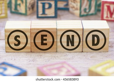 SEND word written on wood cube