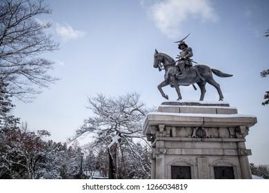 Sendai, Miyagi Prefecture, Japan - February 2018 : A statue of Masamune Date on horseback entering Sendai Castle in Aobayama Park, Sendai.