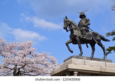 Sendai, Miyagi Prefecture, Tohoku region, Japan - April 15, 2017: Statue of Date Masamune riding on  a horse located on Mount Aoba.