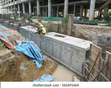 SENDAYAN, MALAYSIA -JANUARY 27, 2017: Underground precast concrete drainage under construction at the construction site in Sendayan, Malaysia.
