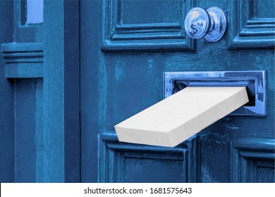 Sending a Gift In The Post.Postal white box the parcel is delivered through the parcel door opening.White post box and old aged grunge blue wooden door.