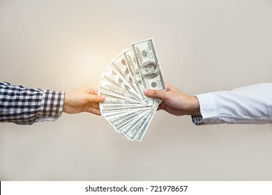 Sending money from one hand to another. Some pay money for trading,buy something , exchanging or sending fraudulent money, corruption.