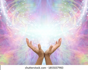 Sending you Distant Healing Assisted by Angels  - female cupped hands reaching up into an Angelic shimmering sparkling  pink ethereal energy background with copy space