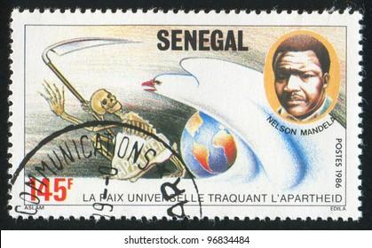 SENEGAL - CIRCA 1986: A stamp printed by Senegal, shows Mandela, dove, death, circa 1986