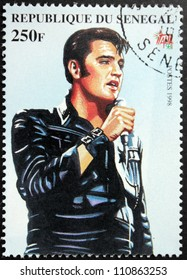 SENEGAL - CIRCA 1998. A postage stamp printed by Senegal shows image portrait of famous American singer Elvis Presley (1935-1977), circa 1998.