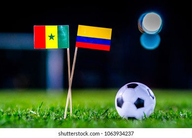 Senegal - Columbia, Group H, Thursday, 28. June, Football, World Cup, Russia 2018, National Flags on green grass, white football ball on ground.