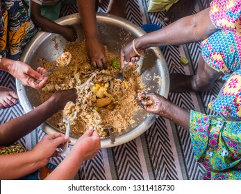 Senegal family eating together in the traditional manner. Senegal. Africa.