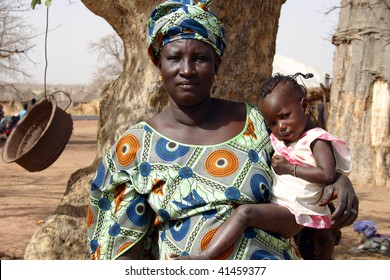 SENEGAL - FEBRUARY 13: Mother sits beside his son in Peul village near Wassadou, February 13, 2007 near Wassadou, Senegal