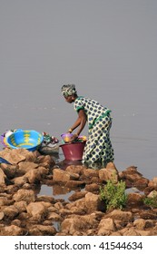 SENEGAL - FEBRUARY 14: African woman comes to wash into the river, the villages have no running water, February 14, 2007 in Country Bassari, Senegal.