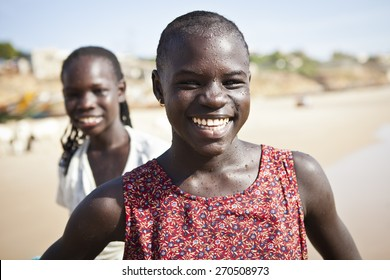 SENEGAL, Ndayane - November 9, 2013: Senegalese children on the beach of Ndayane, playing and waiting for their father to come back from fishing. Despite poverty, Senegal kids stay smiling.