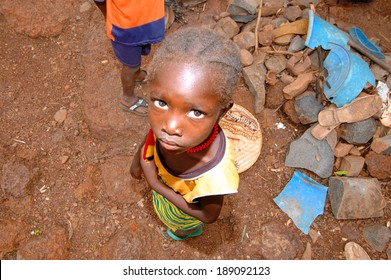 SENEGAL - SEPTEMBER 17: Little girl from the Bedic ethnicity, the Bedic living on the margins of society on top of a hill, on September 17, 2007 in Country Bassari, Senegal