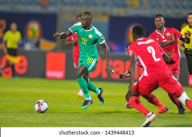 Senegal's Sadio Mane drives the ball during the 2019 Africa Cup of Nations (CAN) Group C football match between Kenya and Senegal at the 30 June Stadium in the Egyptian capital Cairo on July 1, 2019.