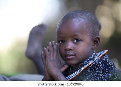 SENETO CULTURAL BOMA, NCA/TANZANIA-CIRCA FEBRUARY 2013: portrait of unidentified Masai child. Circa February 2013 in Seneto Cultural Boma. Masai are pastoralist people of east Africa.