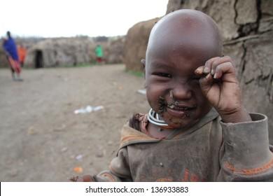 SENETO CULTURAL BOMA, NCA/TANZANIA-CIRCA FEBRUARY 2013: portrait of unidentified Masai kid. Circa February 2013 in Seneto Cultural Boma. Masai are pastoralist people of east Africa.