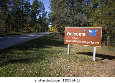 Seney, Michigan, USA - October 13, 2018: Entrance sign for the Seney National Wildlife Refuge in the Upper Peninsula. The refuge has auto nature trail, hiking trails, fishing and bird watching.