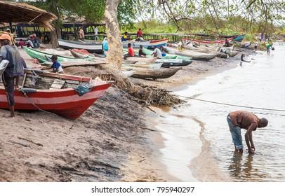 SENGA BAY, MALAWI - SEPTEMBER 05 2009: Local Malawian people use Lake Malawi for fishing, washing, bathing. Their dug out canoes are called mokoros.