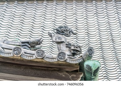 Sengaku-ji Soto Zen Buddhist temple. shachi or shachihoko (killer whale) Fish shaped ornament at Tomebuta gawara (end of a roof-ridge). Located in Takanawa district of Minato ward, Tokyo, Japan.