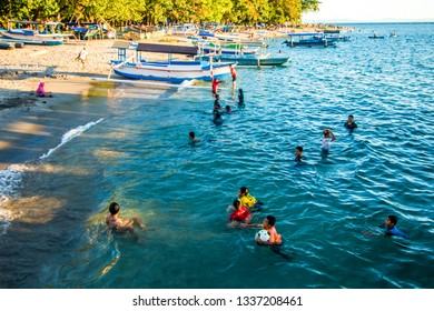 Senggigi Beach,Lombok, Indonesia - March 10, 2018: Tourist visiting Senggigi beach and enjoying sunset moment. Senggigi beach is a hidden paradise in lombok island, indonesia.
