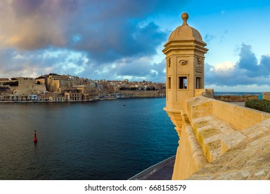 Senglea, Malta - Sunset and panoramic skyline view at the watch tower of Fort Saint Michael, Gardjola Gardens with beautiful sky and clouds