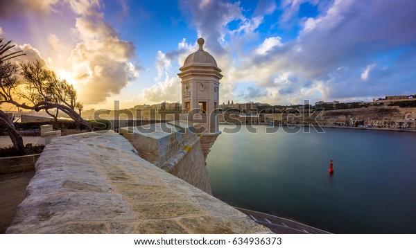 Senglea, Malta - Watch tower at Fort Saint Michael, Gardjola Gardens at sunset with beautiful sky and clouds