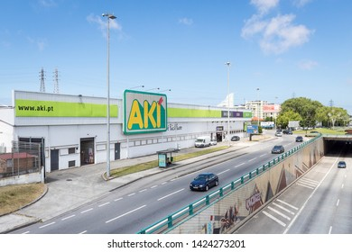 "Senhora da Hora, Matosinhos, Portugal - June 14, 2019: Facade of the commercial building ""AKI"" next to the AEP roundabout"