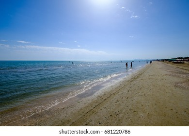 Senigallia Beach. View under umbrellas and main beach.