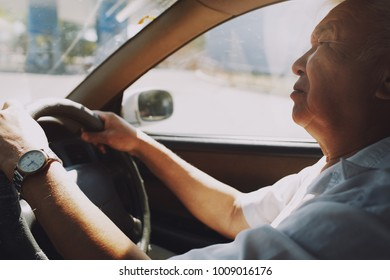 Senior 65-70 years man driving car