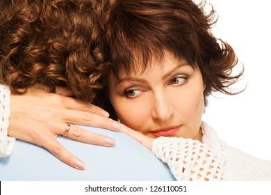 Senior adult couple with a bit sad wife hugging his husband