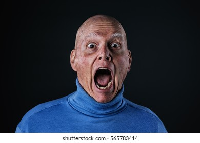 Senior adult male with a surprised, terrified expression on his face