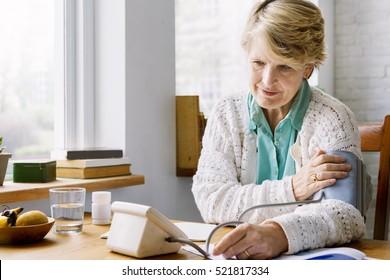 Senior Adult Measuring Blood Pressure