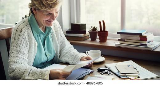 Senior Adult Reading Letter Concept